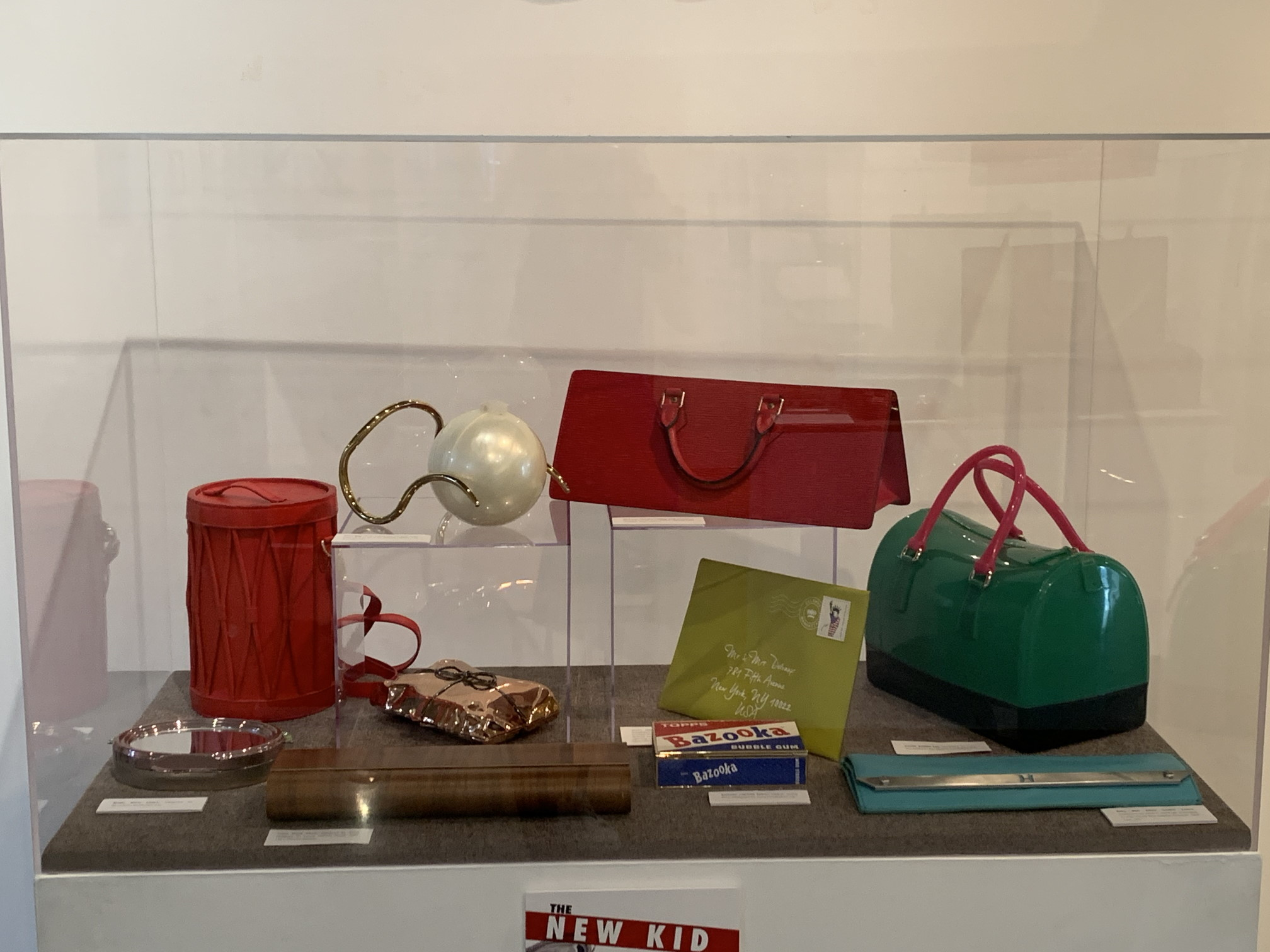 "Installation View of the exhibition ""PURSEonality; A Stylish Handbag History,"" Gallery 109 and Anthony R. Abraham Family Gallery, Coral Gables Museum."