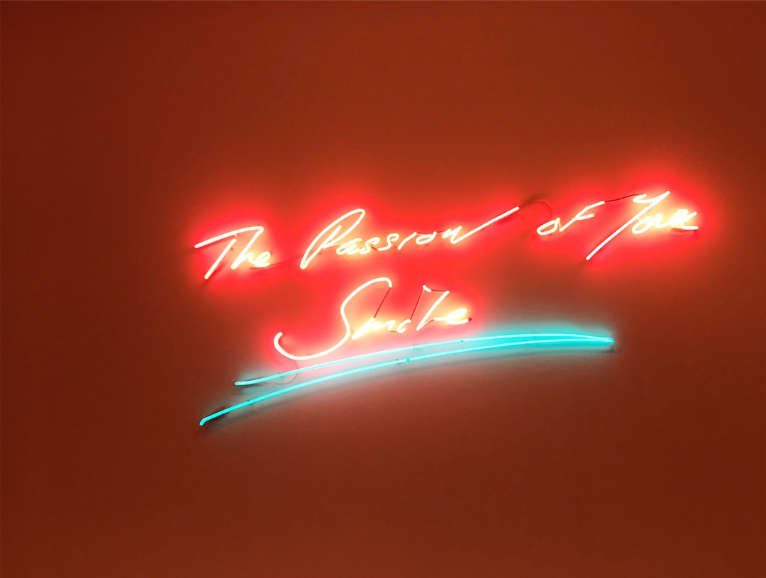 """The passion of your smile"" (2013) features Tracey Emin's signature handwriting in an illuminating neon"