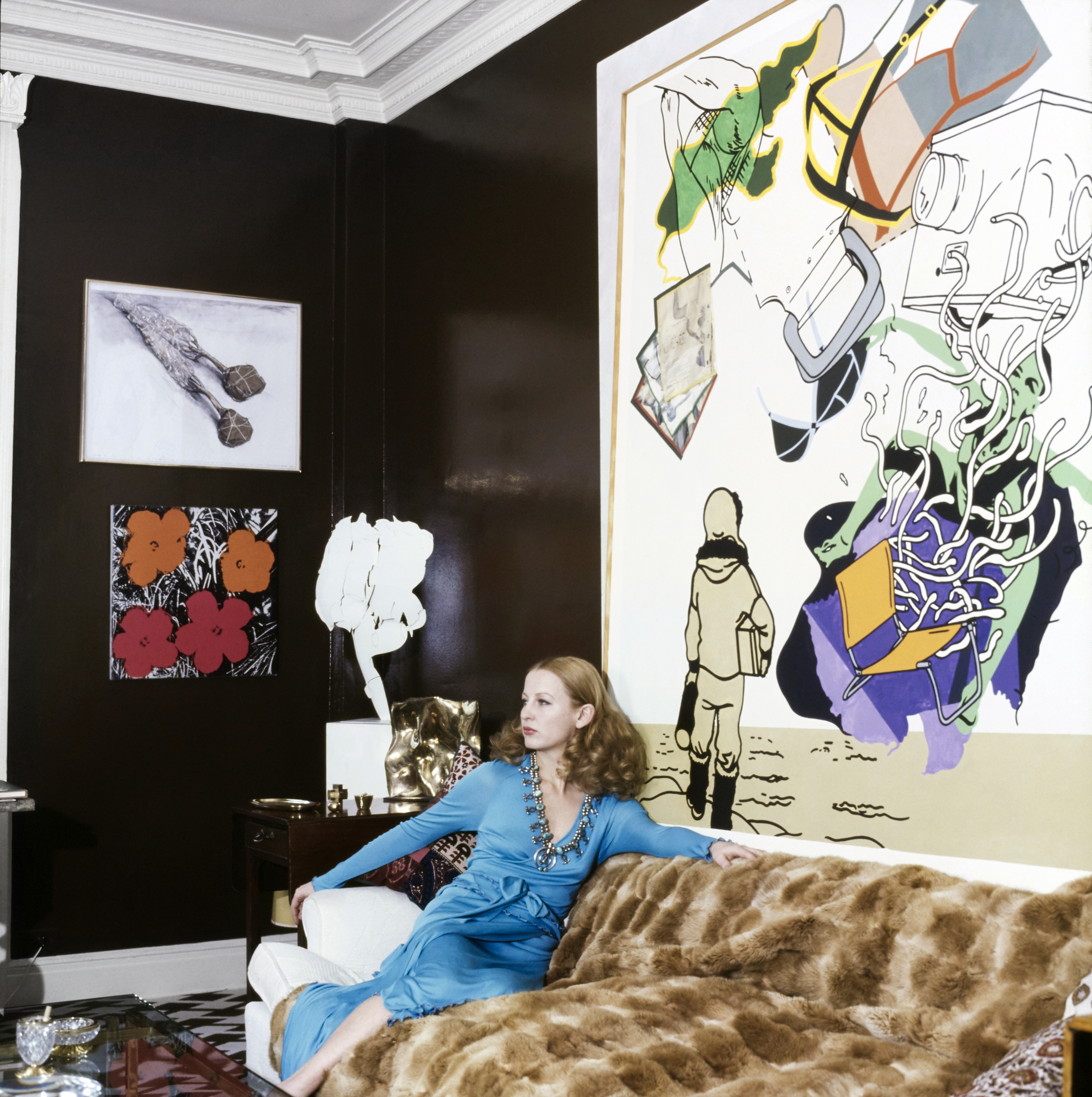September 01, 1972 - Art collector Jeanette Bonnier in the library of her New York apartment where dark-chocolate walls frame a Talemark painting, left, and, on the far wall a Christo hangs over a Warhol silkscreen flower