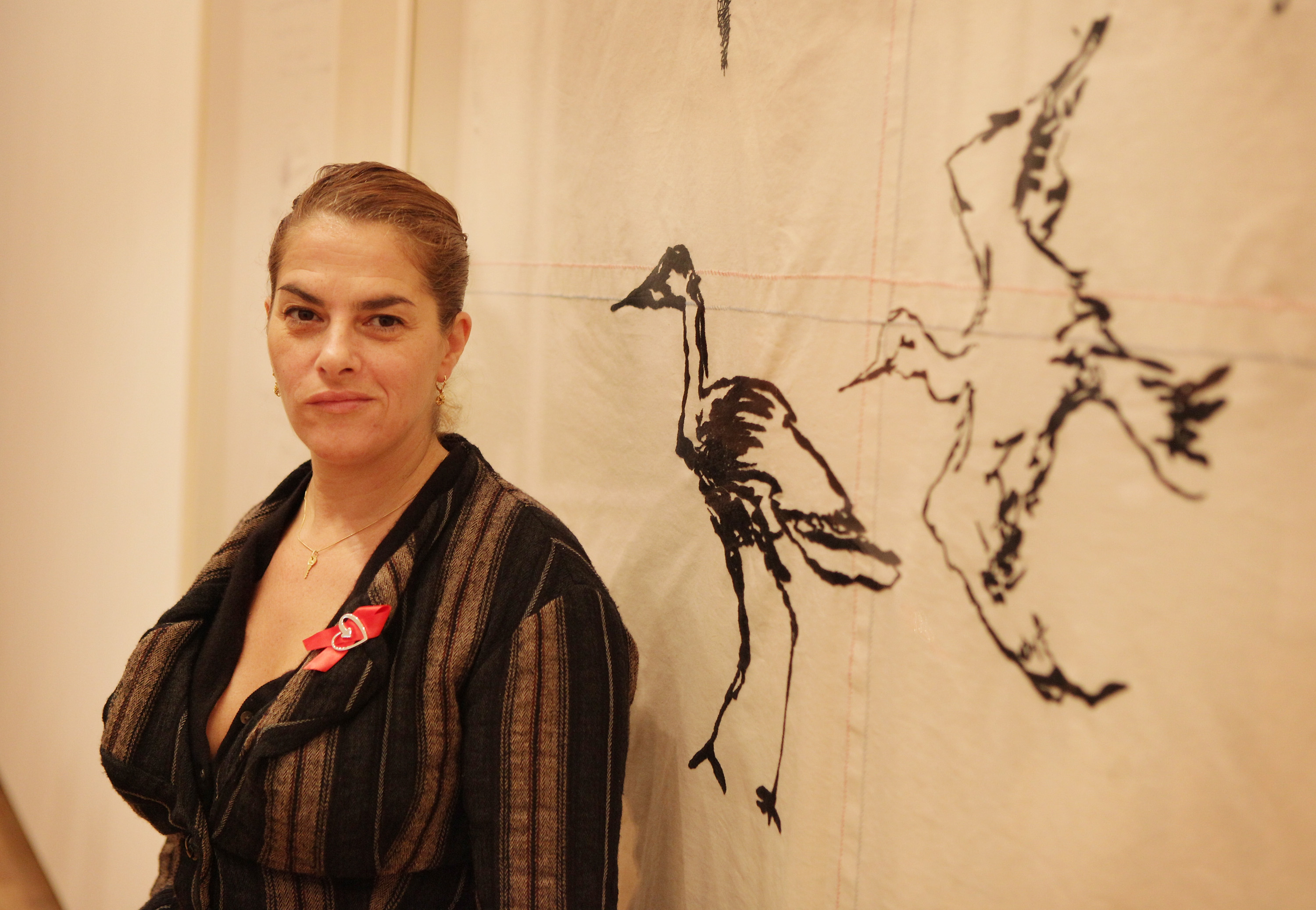 Artist Tracey Emin stands in front of her new painting entitled 'Throw Yourself at Anyone, 2009' at the Royal Academy of Arts 'Earth: Art of a Changing World' exhibition