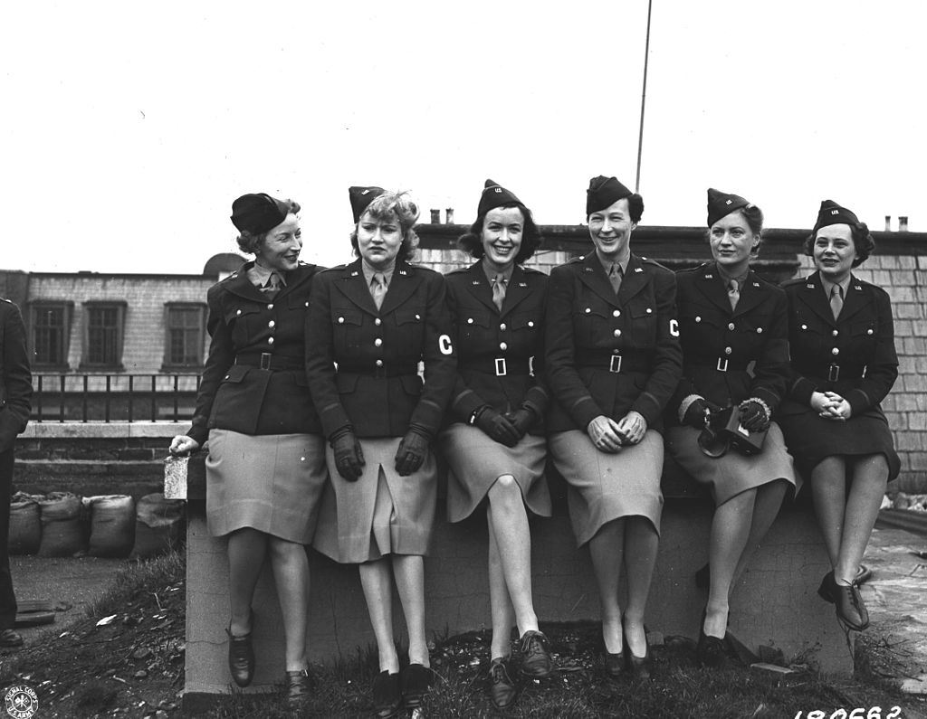 Caption: Six female war correspondents who covered the U.S. Army in the European Theater during World War II appear together in this 1943 photograph: Mary Welch, Dixie Tighe, Kathleen Harriman, Helen Kirkpatrick, Lee Miller, Tania Long