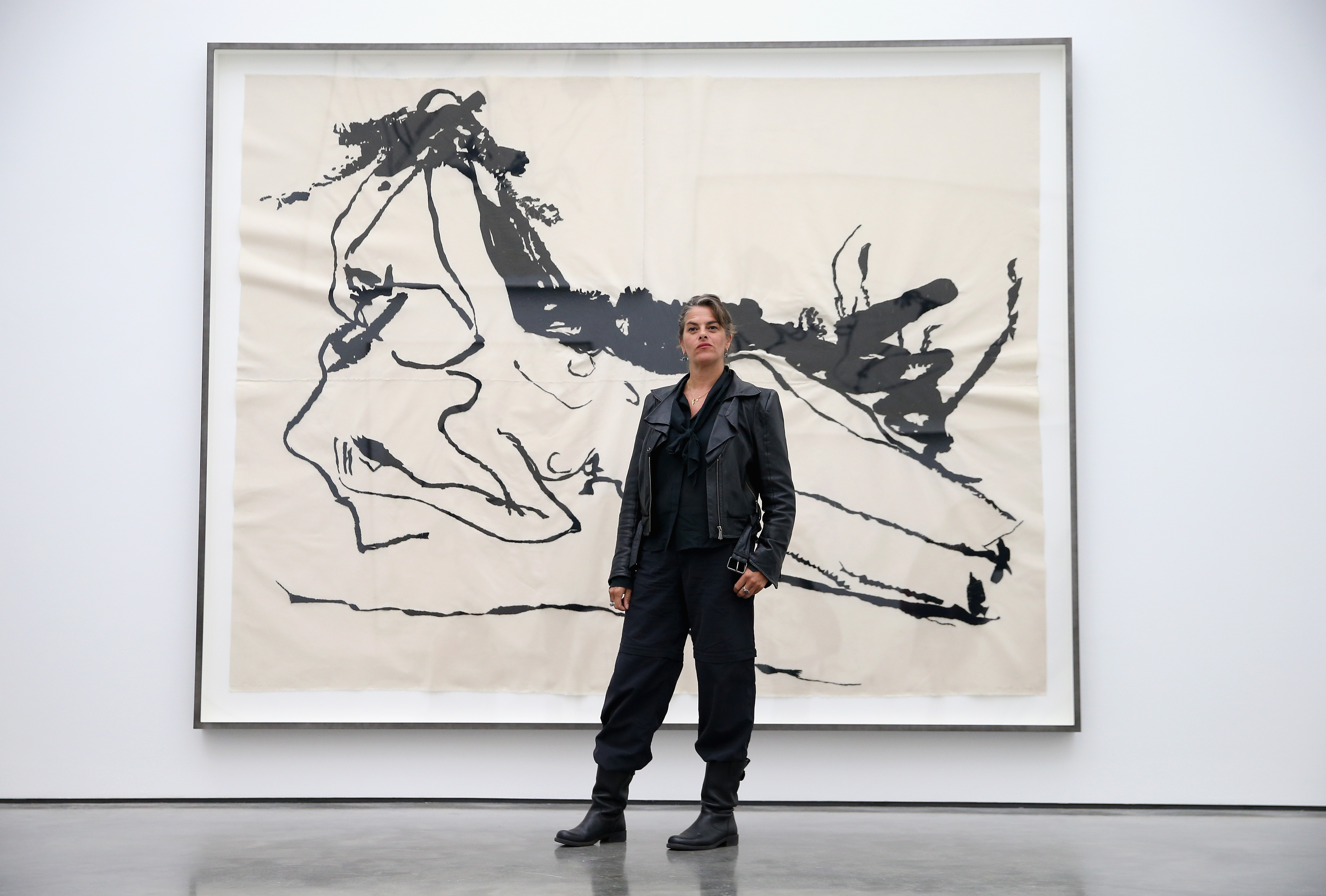 "Artist Tracey Emin poses in front of her work as part of her ""The Last Great Adventure is You"" Exhibition at the White Cube Gallery"