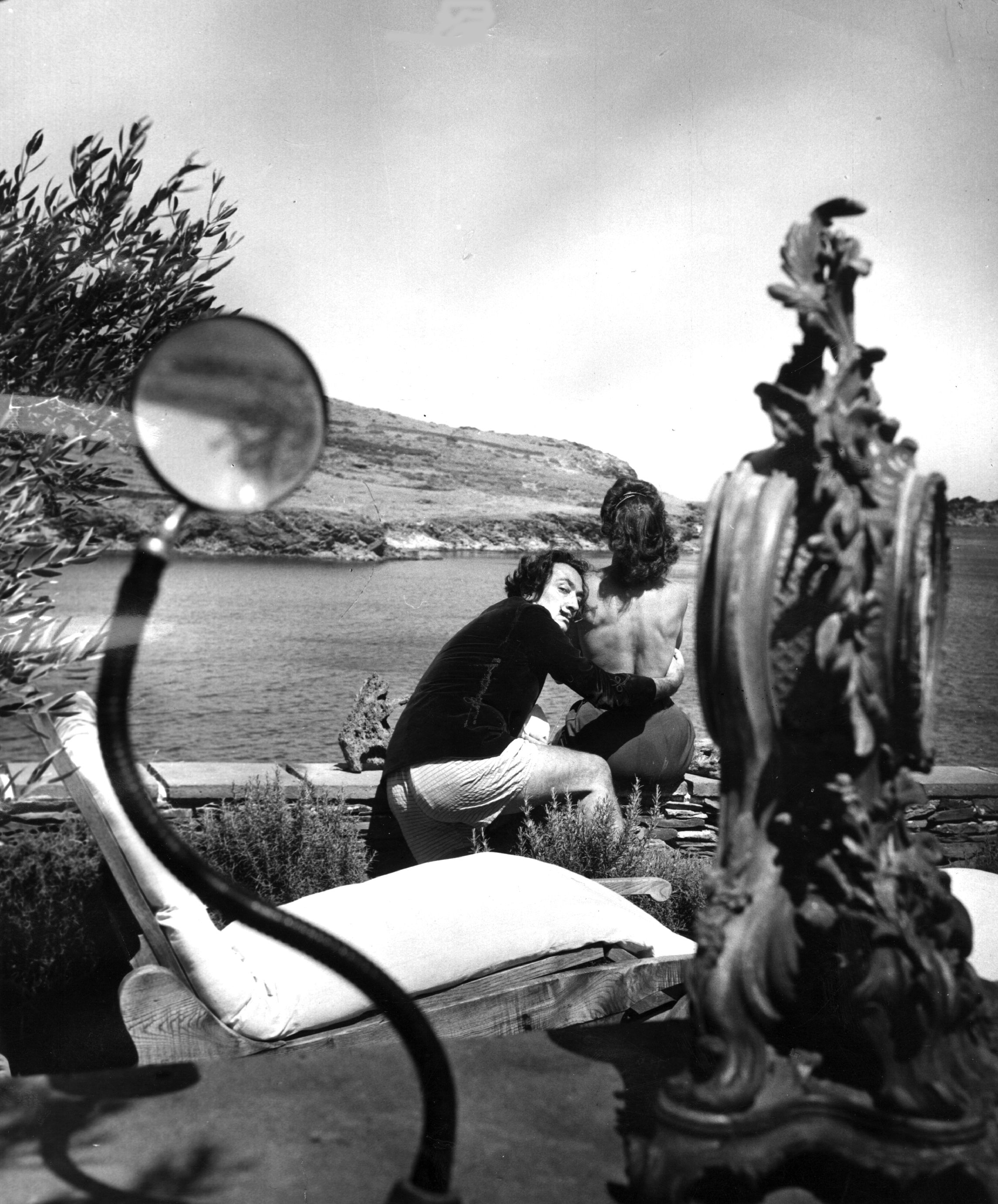 Spanish surrealist artist Salvador Dali (1904 - 1989) with his wife Gala (1894 - 1982) at the garden of his home in Cadaques on the Spanish Costa Brava