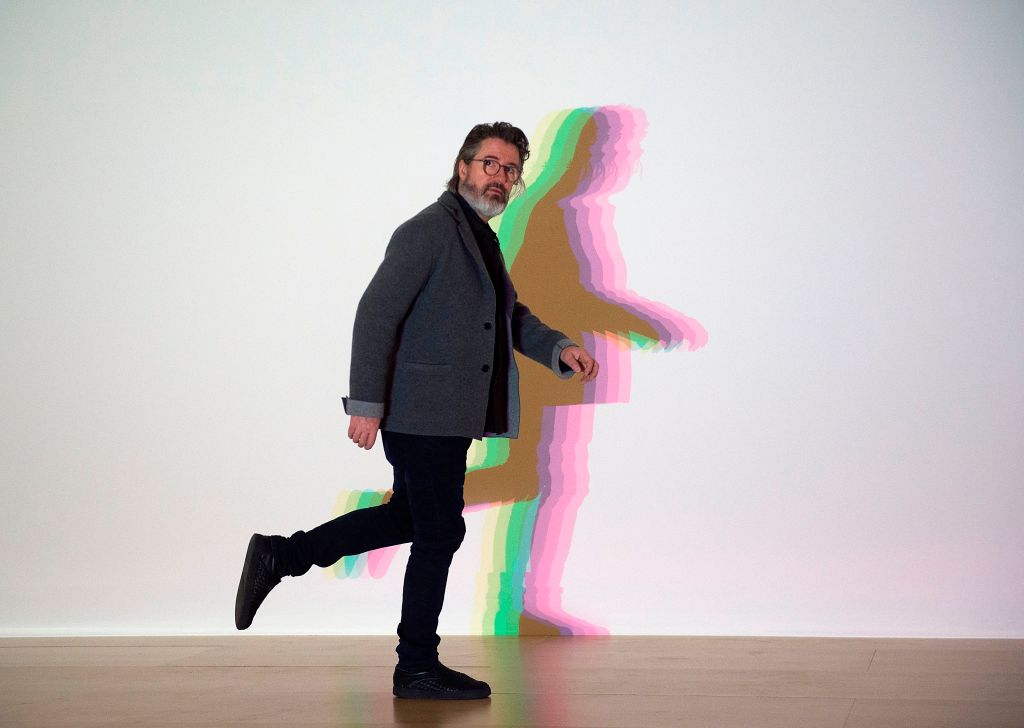 """Danish-Icelandic artist Olafur Eliasson poses in front of his artwork """"Your uncertain shadow"""" during a presentation of the """"Olafur Eliasson: In real life"""" exhibition at the Guggenheim Museum in northern Spanish Basque city of Bilbao on February 13, 2020"""