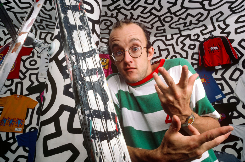 Graffiti artist Keith Haring, known for his squiggly doodles of dogs and humans poses for a portrait in September 1986 in New York City